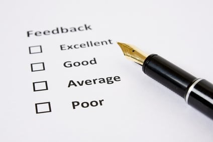 Feedback/Rating sheet with Fountain pen on white background