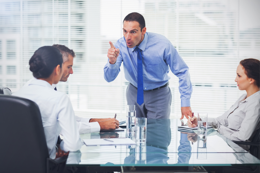 Angry,Executive,Pointing,Out,His,Employee,In,Bright,Office